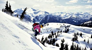 Skiing along mountain backdrop