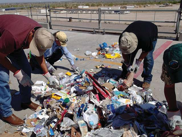 Staff during a recycling audit conducted in April 2012.