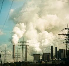 Photograph of smokestacks and power lines.