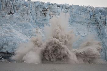 Image of a glacier calving.