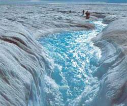 Photograph of river running through glacier.