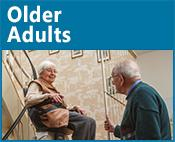 Older Adults icon: image of a person using a stair lift