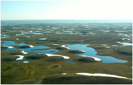 Image shows prarie potholes filled with water.