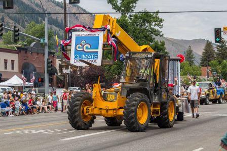 Hailey Community Climate Challenge forklift carries sign