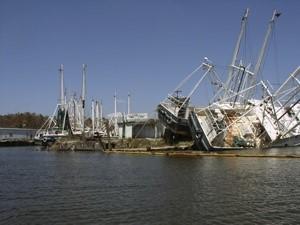 Photograph of damaged fishing boats at a port after Hurricane Katrina.