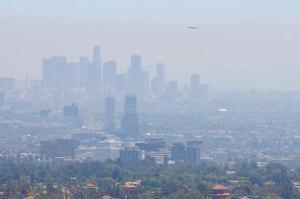 Photograph of smog above an urban landscape.