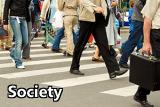 People walking across a busy crosswalk.